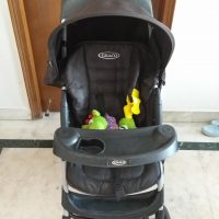 Pre-Loved, easy to fold Graco Pram with 5 point harness and extra child cover